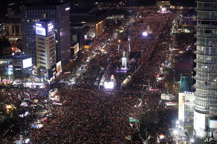 Protesters occupy major streets in the city center for a rally against South Korean President Park Geun-hye in Seoul, South Korea, Saturday, Dec. 3, 2016.