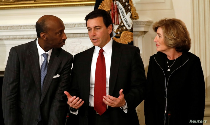 Ford Motor Company CEO Mark Fields, center, is flanked by Merck & Co. CEO Ken Frazier and Campbell's CEO Denise Morrison at a meeting held by President Donald Trump with manufacturing CEOs at the White House in Washington, Feb. 23, 2017.
