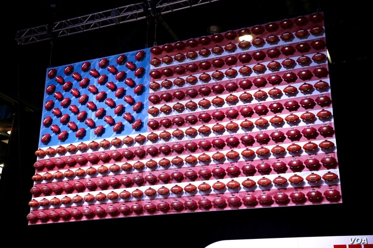The Super Bowl is the most-watched American sporting event of the year. This American flag has been decorated with Wilson footballs, the company that manufactures every football that is used by the NFL. (B. Allen/VOA)