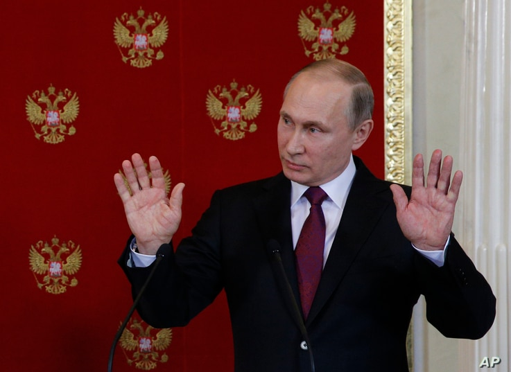 Russian President Vladimir Putin reacts during a joint press conference with Italian counterpart Sergio Mattarella after a meeting in Moscowís Kremlin, Russia, April 11, 2017. S