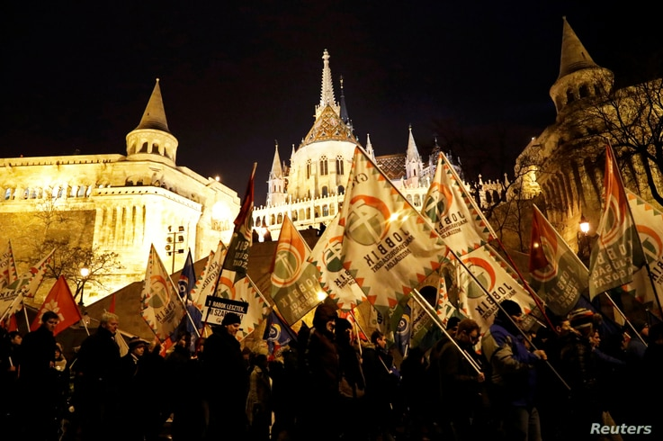 People protest after Hungarian Prime Minister Viktor Orban delivered his annual state of the nation address in Budapest, Hungary, Feb. 10, 2019.
