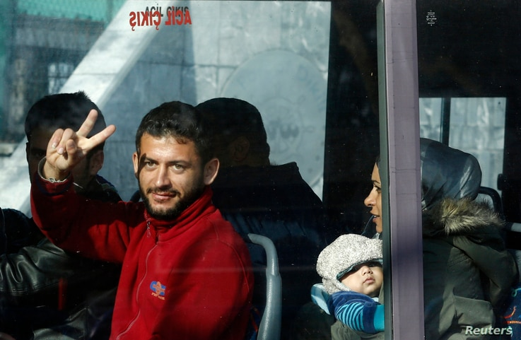 Migrants are seen in a bus as they are moved to a Turkish coastguard station after a failed attempt at crossing to the Greek island of Lesbos, in the Turkish coastal town of Dikili, Turkey, April 6, 2016.