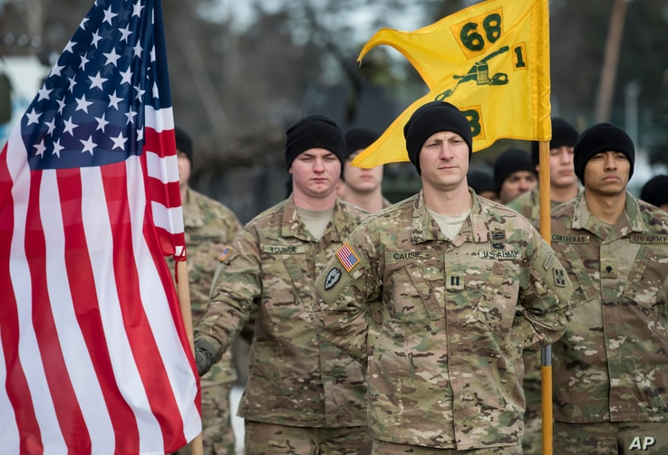 Members of the U.S. Army take part in a NATO battalion welcome ceremony at the Rukla military base  west of the capital Vilnius, Lithuania, Feb. 7, 2017.