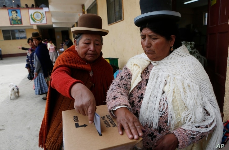 An Aymara woman casts her ballot at a polling station during the constitution referendum in El Alto, Bolivia, Sunday, Feb. 21, 2016.