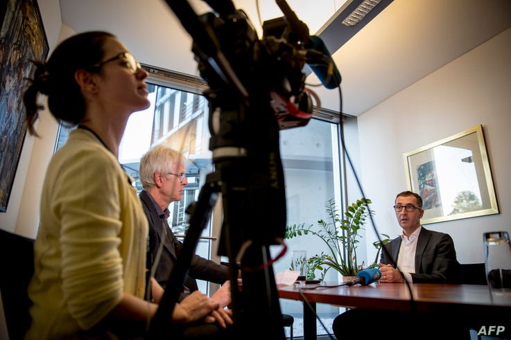 MP for the Greens Cen Ozdemir (R) speaks during an interview with AFP at the parliament in Berlin on Sept, 27, 2018.