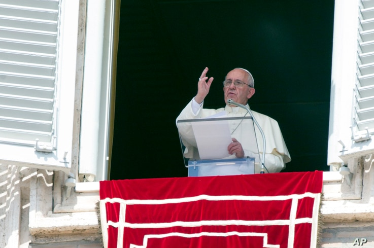 Pope Francis delivers his blessing to faithful during the Angelus noon prayer from his studio window overlooking St. Peter's Square at the Vatican, Sept. 6, 2015.