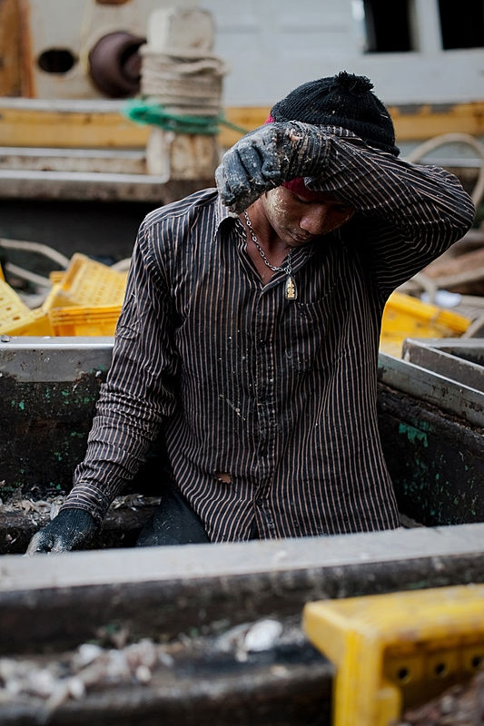 Thousands of men from Myanmar and Cambodia set sail on Thai fishing boats every day, but many are unwilling seafarers -- slaves forced to work in brutal conditions under threat of death, September 1, 2011. (AFP)