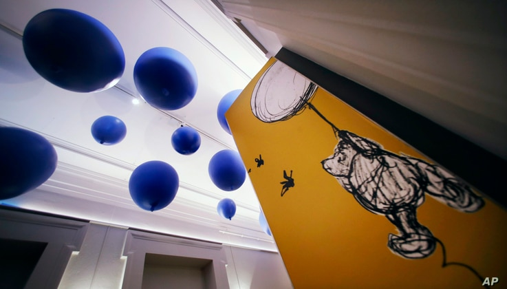 """Giant balloons hang from the ceiling leading to the """"Winnie-the-Pooh: Exploring a Classic"""" exhibit at the Museum of Fine Arts in Boston, Sept. 13, 2018."""