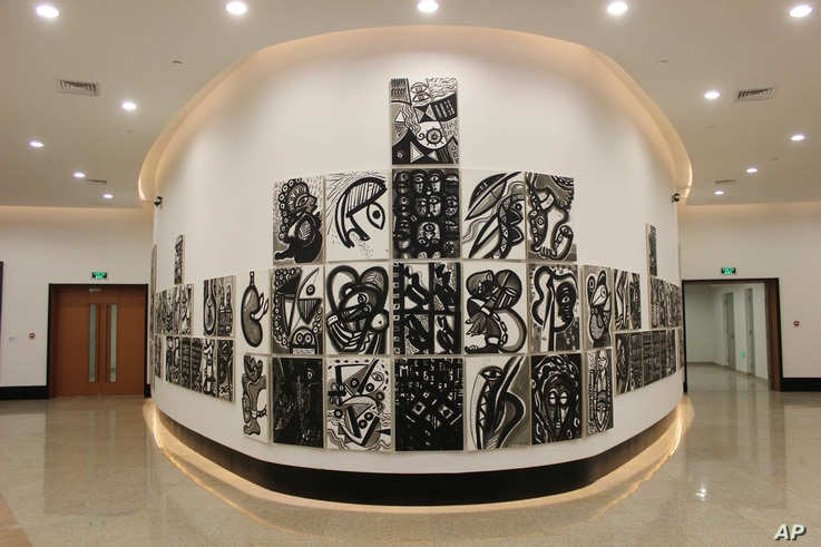 """An installation by Haitian artist Philippe Dodard's """"La Movement en Memoire,"""" stands like a ship inside a gallery of contemporary African art and contemporary art during the inauguration in Dakar, Senegal, Dec. 6, 2018."""