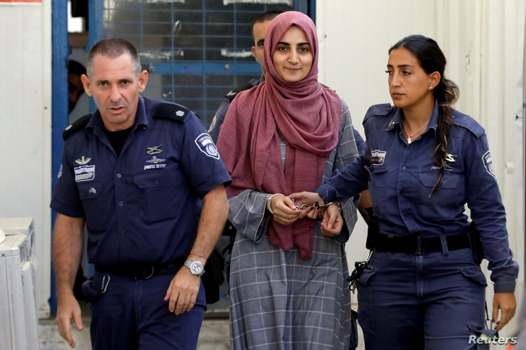 FILE - Turkish citizen, Ebru Ozkan, who was arrested at an Israeli airport last month, is being brought to an Israeli military court, near Migdal, Israel, July 8, 2018.