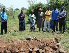 Thuli Makama visits the grave of a villager killed by a game park ranger in Swaziland.