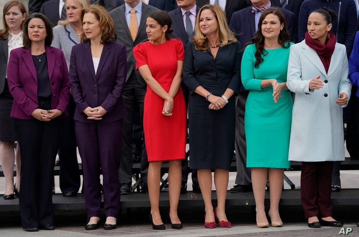 FILE -  from l-r., Rep.-elect Angie Craig, D-Minn., Rep.-elect Kim Schrier, D-WA., Rep.-elect Alexandria Ocasio-Cortez, D-NY., Rep.-elect Debbie Mucarsel-Powell, D-Fla., Rep.-elect Abby Finkenauer, D-Iowa, and Rep.-elect Sharice Davids, D-KS., line u...