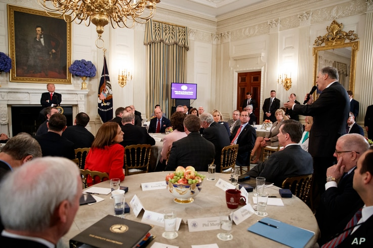 Gov. Jay Inslee, D-Wash., right, speaks about school safety during an event with President Donald Trump and members of the National Governors Association in the State Dining Room of the White House, Feb. 26, 2018.