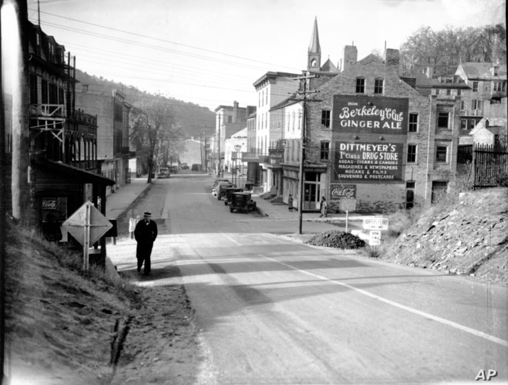 This is a photo of Shenandoah Street in Harpers Ferry, West Virginia, in March 1938. Harpers Ferry town, located at the confluence of the Shenandoah and Potomac rivers, was an important arms-producing center by the mid 1800s.
