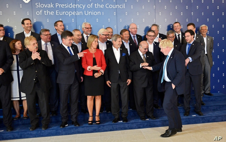 Boris Johnson, Foreign Secretary of Britain, front right, arrives for a group photo during an informal meeting of EU Foreign Ministers in Bratislava, Slovakia, Sept. 2, 2016.