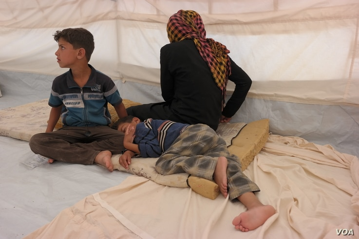 "Mohammed (9, sitting up) told us: ""My feet were very painful and tired afer having to run all night"".  Ishwaq, her husband and their three children (all under the age of 12) managed to escape Fallujah on Monday 23 May 2016. They only managed to bring..."