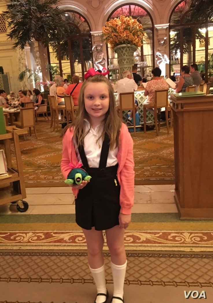 Eloise fan, Annie Clark, poses in the lobby of the Plaza Hotel.