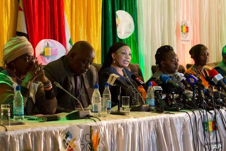 Zimbabwe Electoral Commission Chairwoman Qhubani Moyo, center, announces the results of the presidential election in Harare, Zimbabwe, Aug. 3, 2018. Emmerson Mnangagwa of the ZANU-PF party was declared winner in the first vote since the fall of longt...