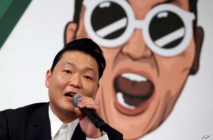 South Korean singer Psy answers a reporter's question during a news conference on the release of his seventh album in Seoul, South Korea, Nov. 30, 2015.