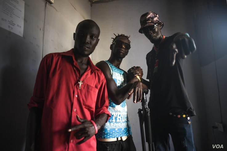 South Sudanese rapper Lual D'awol poses with fellow hip-hop artists in a recording studio in Juba, June 4, 2016. (J. Patinkin/VOA)