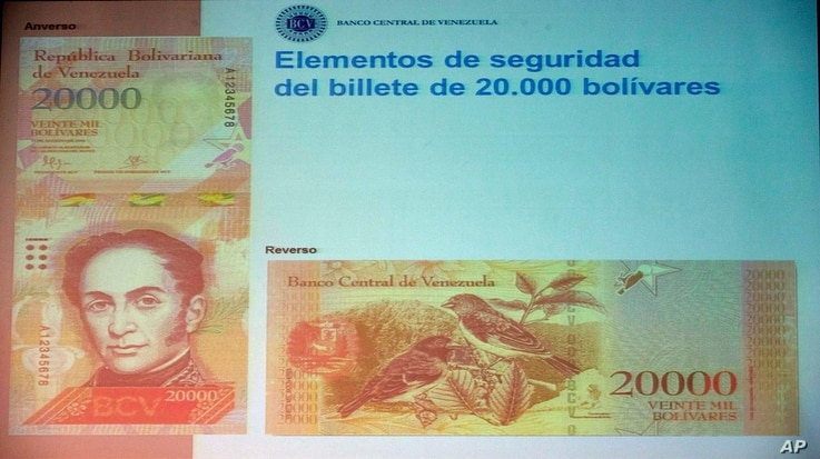 The front and back of the newly issued 20,000 Bolivar is displayed during a news conference in Caracas, Venezuela, Dec. 7, 2016.