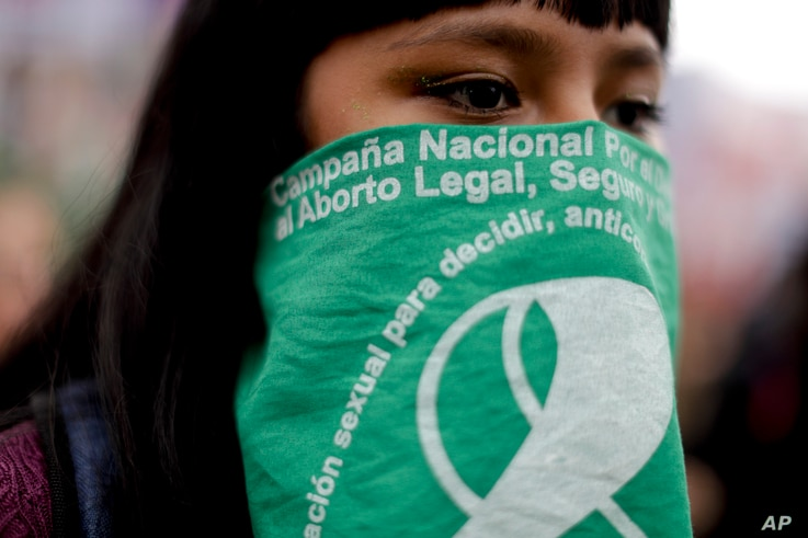 A demonstrator in support of decriminalizing abortion stands outside Congress in Buenos Aires, Argentina, Aug. 8, 2018.