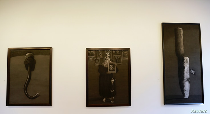 Artworks by Syrian artist Youssef Abdelke are displayed at a gallery in Beirut, Lebanon, Jan. 6, 2014.
