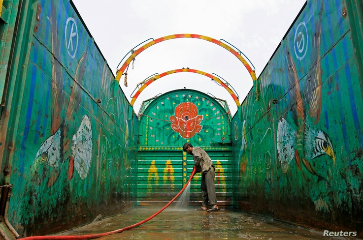 A worker washes a decorated truck in Peshawar, Pakistan, May 2, 2017.