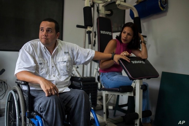 Javier Hernandez, a former employee of a state-run cement factory, and his wife, Denitza Colmenarez, a 39-year-old public-school teacher, are seen during an interview at their home in Guatire Venezuela, Aug. 3, 2017.