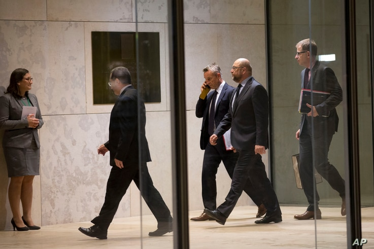 President of the European Parliament Martin Schultz, second from right, arrives at the Maltese parliament to delivers a speech on the occasion of a migration summit in Valletta, Malta, Tuesday, Nov. 10, 2015.