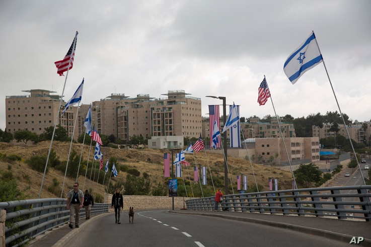 Security officers walk on a road leading to the US Embassy compound ahead the official opening in Jerusalem,  May 13, 2018.