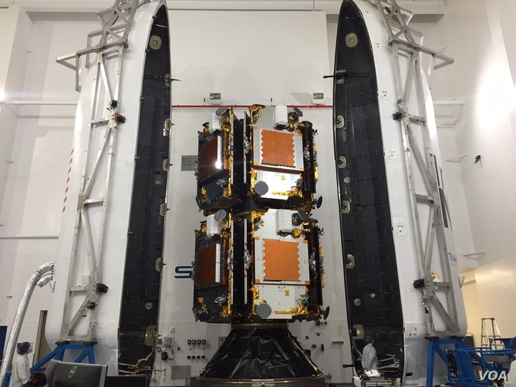 "This is a photo of the first 10 Iridium NEXT satellites, inside the SpaceX ""dispenser,"" the payload fairing used to protect the satellites during the rocket launch. (Credit: Iridium)"