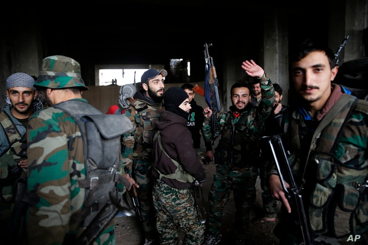 Syrian army soldiers prepare for battle with rebels at the Ramouseh front line, east of Aleppo, Syria, Dec. 5, 2016.