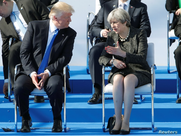 U.S. President Donald Trump and Britain's Prime Minister Theresa May during a ceremony at the new NATO headquarters before the start of a summit in Brussels, Belgium, May 25, 2017.