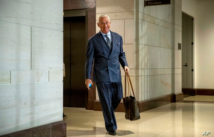 FILE - Longtime Donald Trump associate Roger Stone arrives to testify before the House Intelligence Committee, on Capitol Hill in Washington, Sept. 26, 2017.