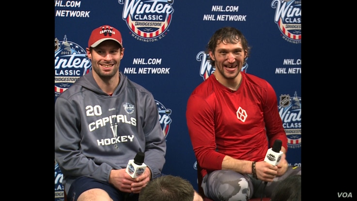 Capitals forwards Troy Brouwer and Alex Ovechkin who both scored in the Washington's New Year's Day Winter Classic victory over Chicago. (VOA News/Arash Arabasadi)