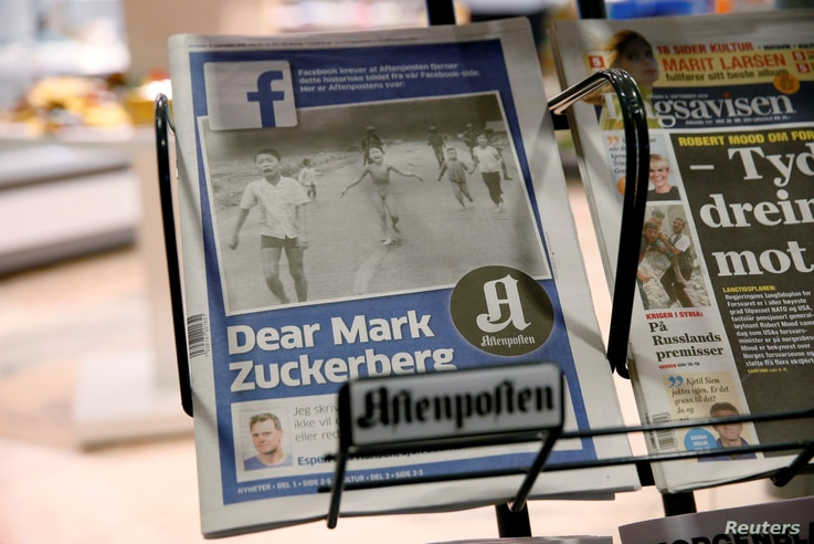 The front page of Norway's Aftenposten is seen at a news stand in Oslo, Norway, Sept. 9, 2016. The newspapers chief editor accused Facebook of abusing its power after it deleted an 1972 iconic image of a nude Vietnamese girl running from a napalm att...