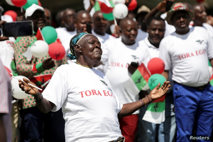 A supporter of Burundi's ruling party, the National Council for the Defense of Democracy-Forces for the Defense of Democracy (CNDD-FDD), dances during their final rally ahead of the referendum in Bujumbura, Burundi, May 14, 2018.