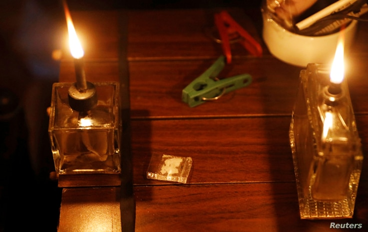 "A sachet of ""shabu,"" or methamphetamine, is pictured between lamps inside a drug den in Manila, Philippines, Feb. 13, 2017."