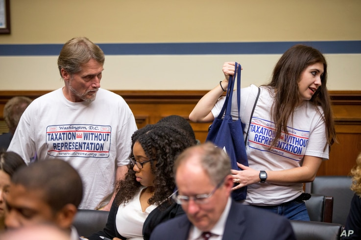 FILE - People in support of statehood for the District of Columbia arrive on Capitol Hill in Washington for a House panel's hearing on whether the district's government truly has the power to spend local tax dollars without approval by Congress, May ...