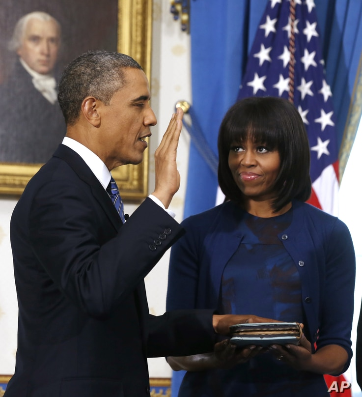 President Barack Obama is officially sworn-in by Chief Justice John Roberts in the Blue Room of the White House,  January 20, 2013.