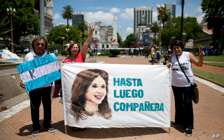 """Government supporters hold a banner that reads in Spanish """"See you soon colleague"""" featuring an image of President Cristina Fernandez in Buenos Aires, Argentina, on Dec. 9, 2015."""