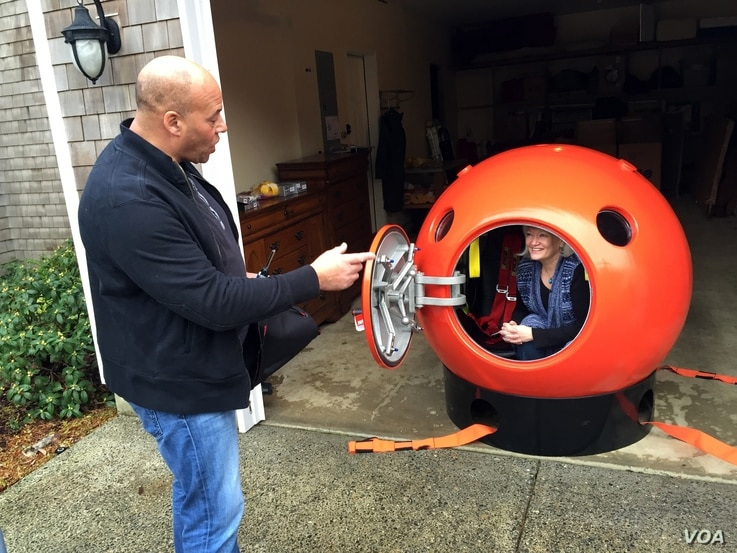 Survival Capsule President Julian Sharpe gives some tips to his first U.S. customer, Jeanne Johnson.
