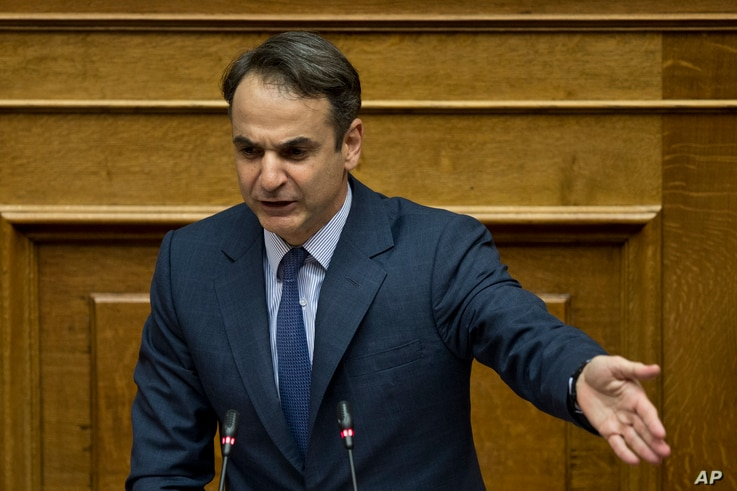 New Democracy party leader Kyriakos Mitsotakis addresses lawmakers during a parliamentary session in Athens, on June 16, 2018.