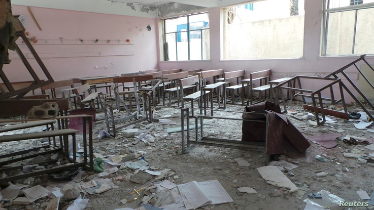 Damaged desks and benches are seen at a school which activists said was damaged by shelling by forces loyal to Syria's President Bashar al-Assad, in Deraa April 10, 2013.