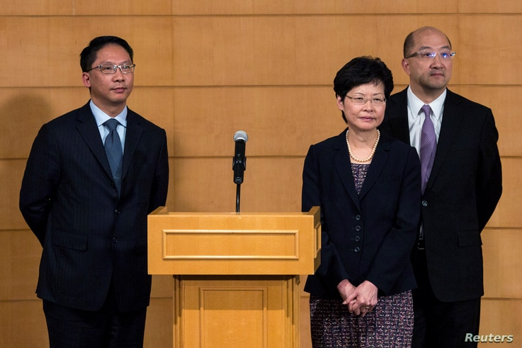Hong Kong's Secretary for Justice Rimsky Yuen (L-R), Chief Secretary for Administration Carrie Lam, Secretary for Constitutional and Mainland Affairs Raymond Tam attend a news conference after meeting with the Hong Kong Federation of Students (HKFS) ...