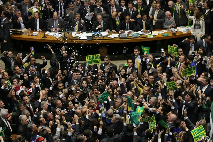 Opposition lawmakers celebrate after the lower house of Congress voted to impeach Brazil's President Dilma Rousseff in the Chamber of Deputies in Brasilia, Brazil, April 17, 2016.