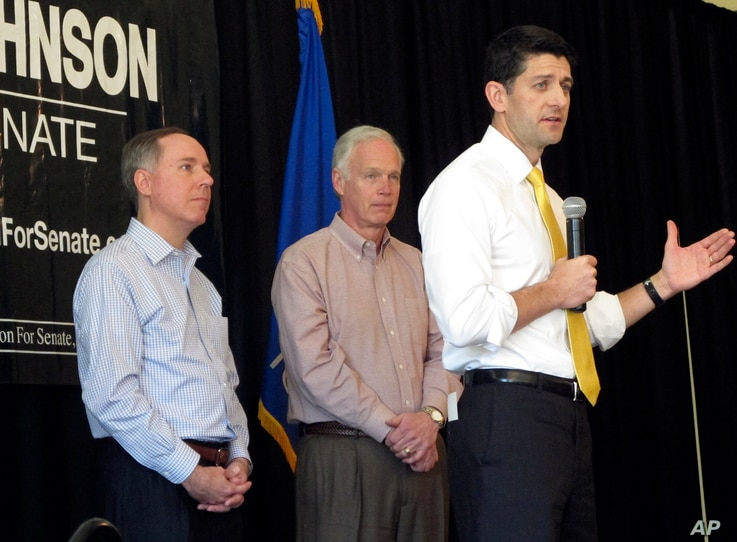 House Speaker Paul Ryan joins Wisconsin state Assembly Speaker Robin Vos, left, and Sen. Ron Johnson, R-Wis., center, at a campaign rally for Johnson in Burlington, Wisconsin, May 5, 2016.