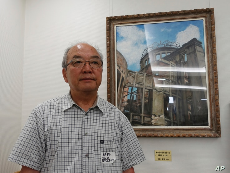 Toshiki Fujimori, an atomic bombing survivor who is a top official at Hidankyo, a Japanese organization for the survivors, stands in front of a painting of the Atomic Bomb Dome in Hiroshima, Japan, Aug, 5, 2017, ahead of the 72nd anniversary of the f...