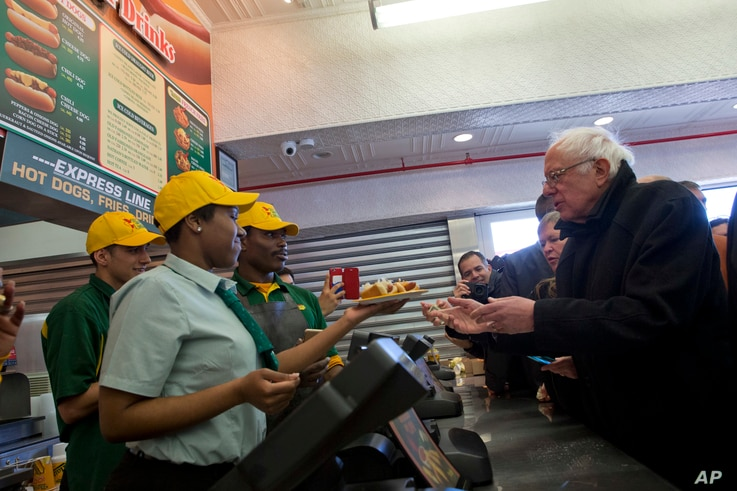 Democratic presidential candidate, Sen. Bernie Sanders, I-Vt., orders hot dogs at Nathans Famous in Coney Island in the Brooklyn borough of New York, Sunday, April 10, 2016.